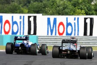 Michael Schumacher, Mercedes GP MGP W01 and Rubens Barrichello, Williams FW32