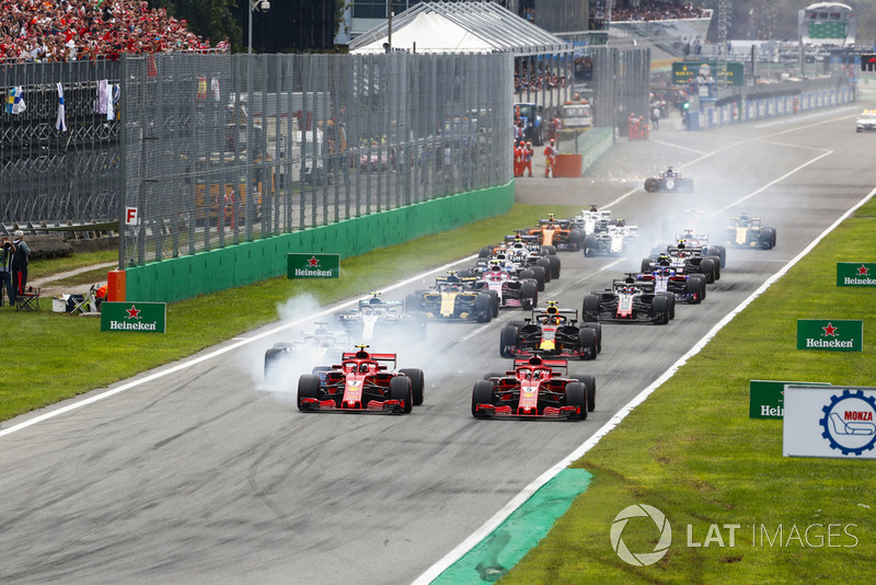 Start of the race with Kimi Raikkonen, Ferrari SF71H, leading Sebastian Vettel, Ferrari SF71H and Lewis Hamilton, Mercedes AMG F1 W09