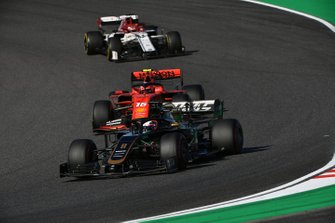 Romain Grosjean, Haas F1 Team VF-19, leads Charles Leclerc, Ferrari SF90, and Kimi Raikkonen, Alfa Romeo Racing C38