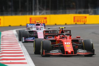 Charles Leclerc, Ferrari SF90, leads Lance Stroll, Racing Point RP19