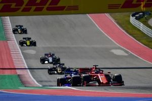 Sebastian Vettel, Ferrari SF90, leads Pierre Gasly, Toro Rosso STR14