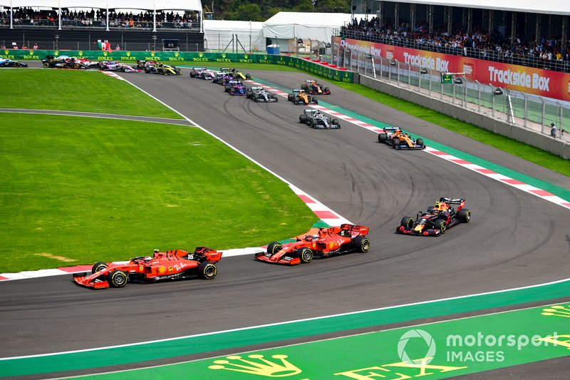 Charles Leclerc, Ferrari SF90, leads Sebastian Vettel, Ferrari SF90, Alex Albon, Red Bull RB15, Carlos Sainz Jr., McLaren MCL34, Lewis Hamilton, Mercedes AMG F1 W10, and the rest of the field on the opening lap