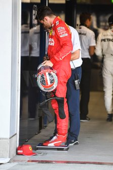 Charles Leclerc, Ferrari, is weighed after Qualifying