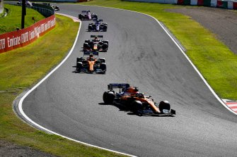 Carlos Sainz Jr., McLaren MCL34, leads Lando Norris, McLaren MCL34, Alex Albon, Red Bull RB15, and Pierre Gasly, Toro Rosso STR14