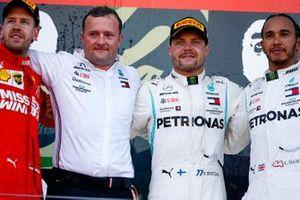 Sebastian Vettel, Ferrari, Race winner Valtteri Bottas, Mercedes AMG F1 and Lewis Hamilton, Mercedes AMG F1 celebrate on the podium