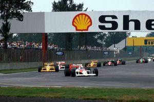 Alain Prost, McLaren MP4/4 leads Nelson Piquet, Lotus 100T