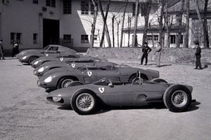 A selection of racing Ferraris are displayed outside the Ferrari factory, including a Ferrari 156