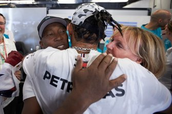 Lewis Hamilton, Mercedes AMG F1, celebrates winning the world championship with his father Anthony and step-mother Linda