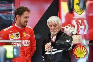 Bernie Ecclestone, Chairman Emiritus of Formula 1, in the Ferrari garage with Sebastian Vettel, Ferrari