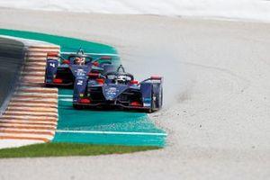 Sam Bird, Envision Virgin Racing, Audi e-tron FE06 gets a tyre on the gravel ahead of Robin Frijns, Envision Virgin Racing, Audi e-tron FE06