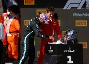 Lewis Hamilton, Mercedes, 1st position, and Charles Leclerc, Ferrari, 2nd position, discuss their race in Parc Ferme