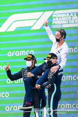 Lewis Hamilton, Mercedes, 1st position, the Mercedes trophy delegate and Valtteri Bottas, Mercedes, 3rd position, on the podium
