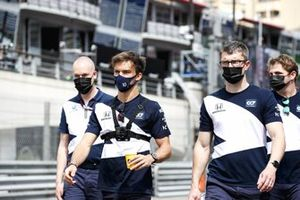 Pierre Gasly, AlphaTauri, walks the track with team mates