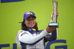 Jamie Chadwick, 1st position, on the podium with her trophy