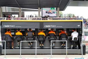 The McLaren team on the pit wall
