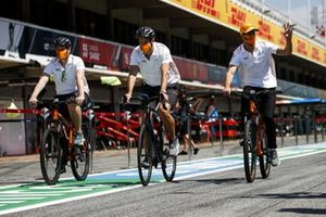 Daniel Ricciardo, McLaren walks the track on a bike