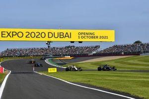 Sebastian Vettel, Aston Martin AMR21, Nikita Mazepin, Haas VF-21, and Esteban Ocon, Alpine A521