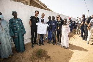 Formula E driver and Veloce Racing co-founder Jean-Eric Vergne, Stephane Sarrazin, Veloce Racing, and Jamie Chadwick, Veloce Racing, pose for a photo with school pupils on the Eco Zone Legacy Project visit