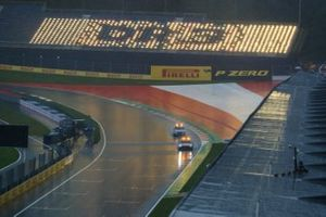 The Safety Car and the Medical Car test the track conditions