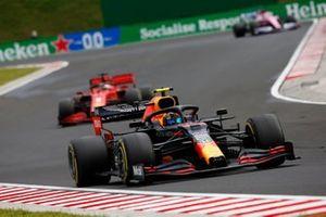 Alex Albon, Red Bull Racing RB16, leads Sebastian Vettel, Ferrari SF1000
