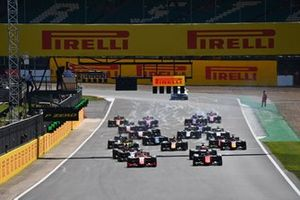 Mick Schumacher, Prema Racing, leads Felipe Drugovich, MP Motorsport, Nikita Mazepin, Hitech Grand Prix, Jack Aitken, Campos Racing, and the rest of the field at the start