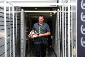 A Schuberth helmet engineer with the helmet of Max Verstappen, Red Bull Racing