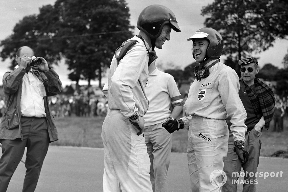 Gurney and Clark try to figure out which of them won the 1964 Belgian GP. Dan ran out of fuel and 'gave' the win to Jimmy; the 'favor' would be returned at the same venue three years later...