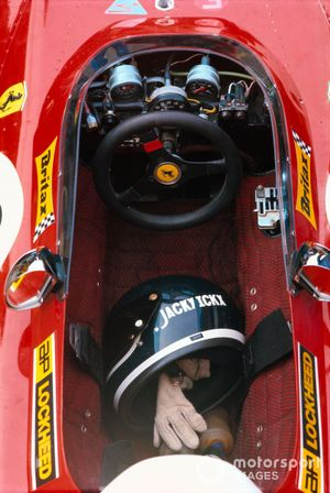 The helmet and gloves of Jacky Ickx in the cockpit of his Ferrari 312B2