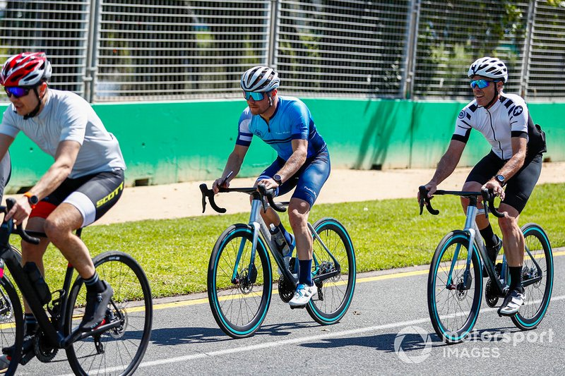 Cyclists ride around the track