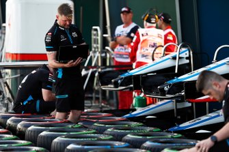The Williams team prepare tyres in the paddock