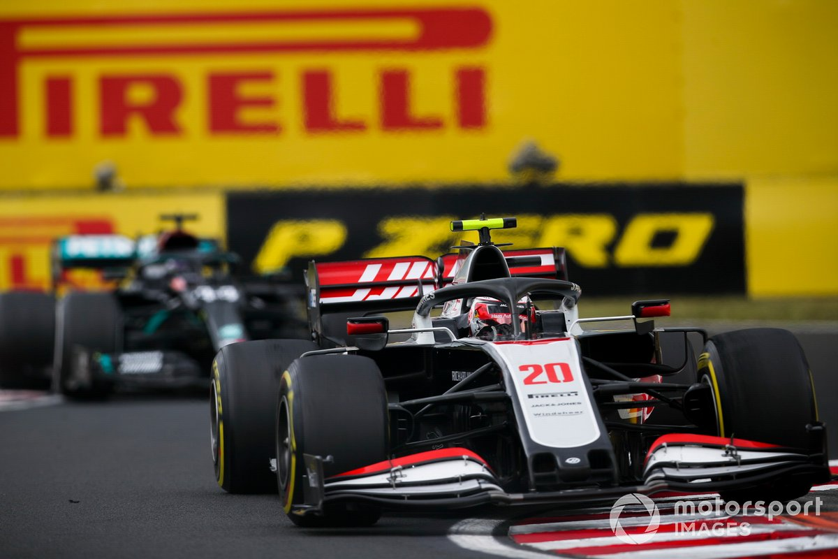 Kevin Magnussen, Haas VF-20, leads Lewis Hamilton, Mercedes F1 W11