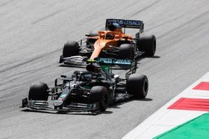 Valtteri Bottas, Mercedes F1 W11 EQ Performance, leads Carlos Sainz Jr., McLaren MCL35