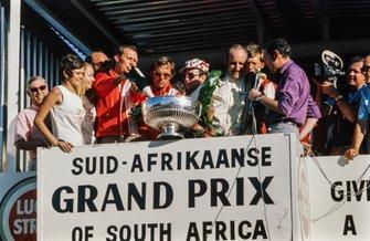 Winner Denny Hulme, McLaren gets interviewed on the podium