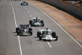 Denny Hulme, McLaren M19A Ford, leads Emerson Fittipaldi, Lotus 72D Ford, and Mike Hailwood, Surtees TS9B Ford