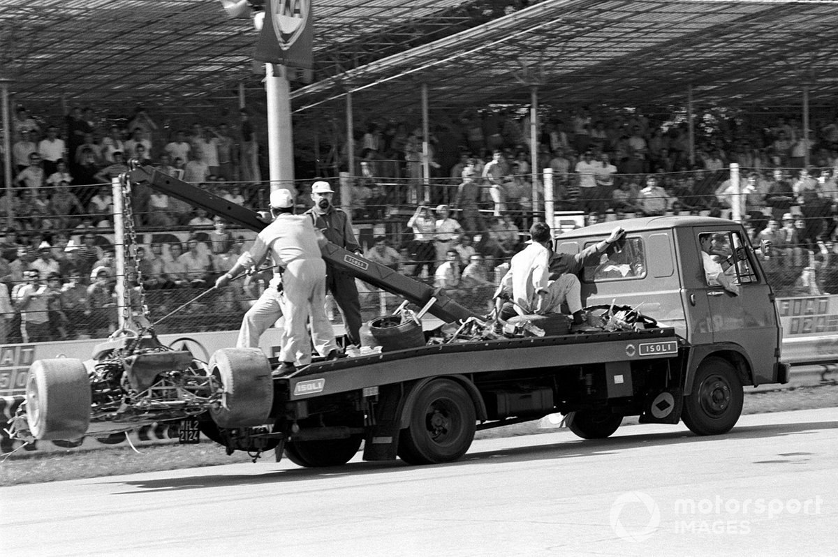 The wreckage of Jochen Rindt's Lotus 72 is carried away after his fatal accident