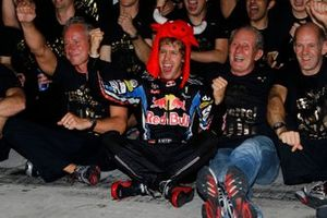 Sebastian Vettel, Red Bull Racing RB6 Renault, Helmut Marko, Consultant, Red Bull, Adrian Newey, Chief Technical Officer, Red Bull Racing, and the Red Bull team celebrate their championship victories