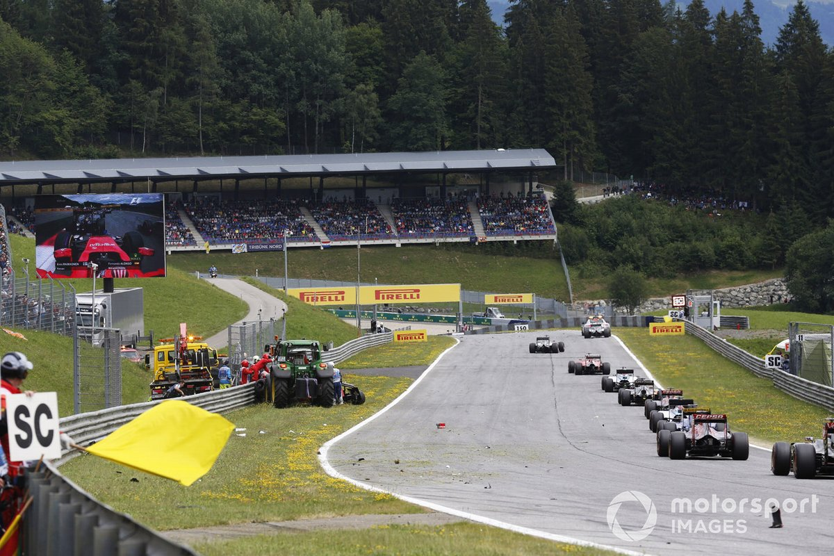 The Safety Car leads the field as Marshals clear the scene of the crash between Kimi Raikkonen, Ferrari SF-15T, and Fernando Alonso, McLaren MP4-30 Honda