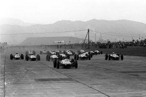 Start action, Dan Gurney Brabham BT7 leads the field