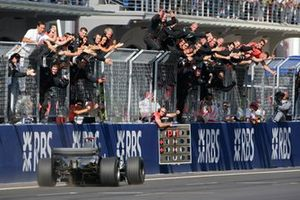Kimi Raikkonen, McLaren Mercedes MP4-20 crosses the line to take victory