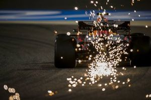 Sparks fly from the rear of Alex Albon, Red Bull Racing RB16