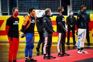 Sebastian Vettel, Ferrari, Carlos Sainz Jr., McLaren, Kevin Magnussen, Haas F1, Romain Grosjean, Haas F1, and George Russell, Williams Racing, on the grid for the national anthem