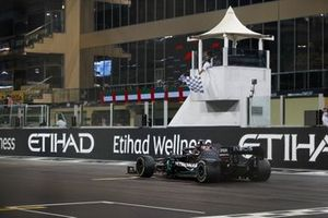 Lewis Hamilton, Mercedes F1 W11, 3rd position, passes the chequered flag