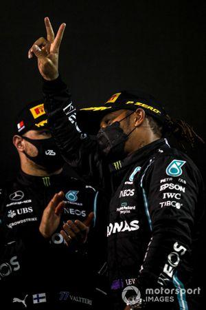 Lewis Hamilton, Mercedes, 1st position, and Valtteri Bottas, Mercedes, 3rd position, celebrate on the podium
