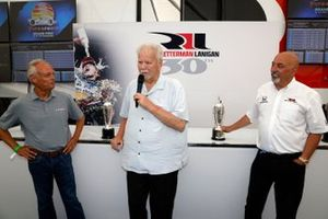 2020 Indy 500 winning team owners Mike Lanigan and Bobby Rahal are presented with the Baby Borg-Warner Trophy by Fred Lissade, BorgWarner President and CEO
