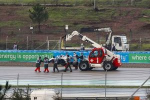 Marshals remove the car of Nicholas Latifi, Williams FW43, from a gravel trap