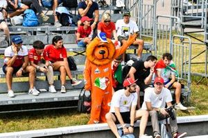 A lion mascot in a grandstand with fans