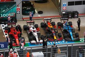 The cars of Charles Leclerc, Ferrari SF21, Antonio Giovinazzi, Alfa Romeo Racing C41, Max Verstappen, Red Bull Racing RB16B, and Esteban Ocon, Alpine A521, in Parc Ferme