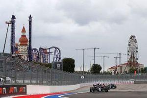 Pierre Gasly, AlphaTauri AT02, Max Verstappen, Red Bull Racing RB16B, and Valtteri Bottas, Mercedes W12
