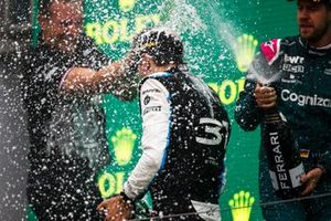 Esteban Ocon, Alpine F1, 1st position, is sprayed with Champagne by Laurent Rossi, CEO, Alpine F1, and Sebastian Vettel, Aston Martin, 2nd position