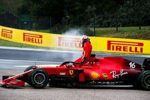 Charles Leclerc, Ferrari SF21, climbs out of his damaged car